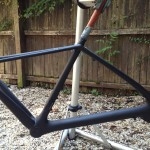 Tarmac Repaired and Primed - Down Tube Damaged.